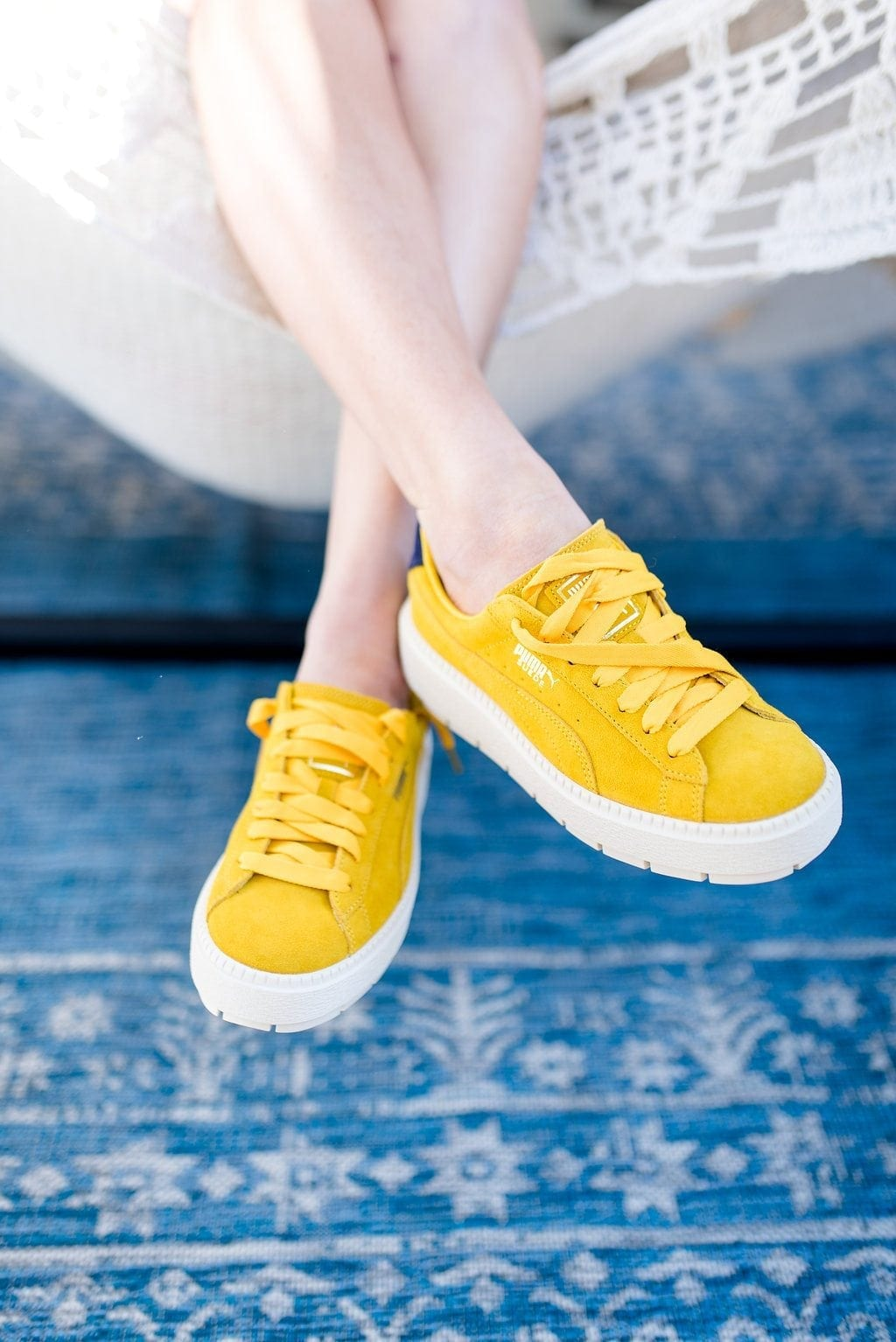 Yellow tennis shoes. Platform sneakers with yellow laces.