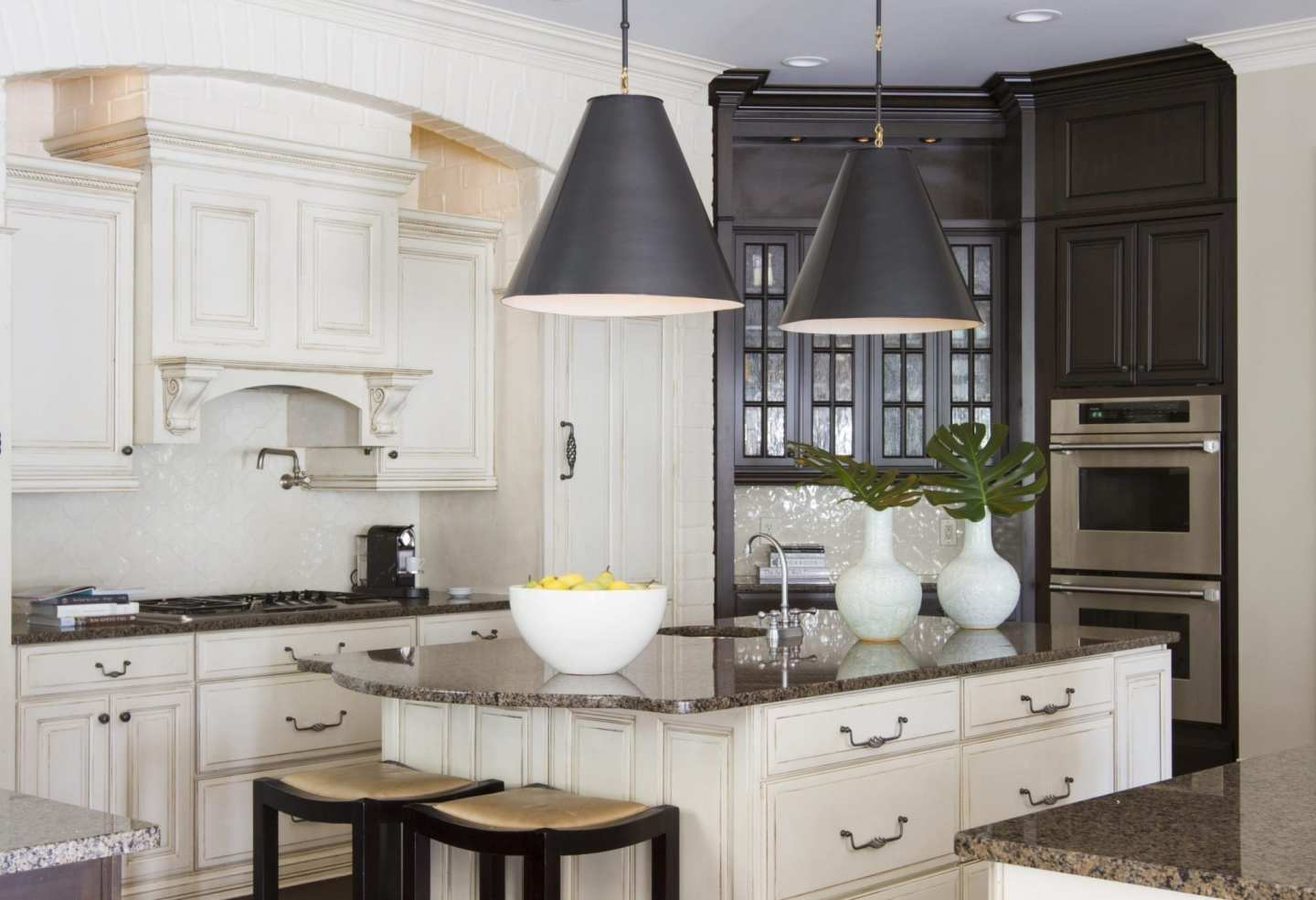 Painted brick kitchen and dark stained cabinetry. White and brown kitchen decor.