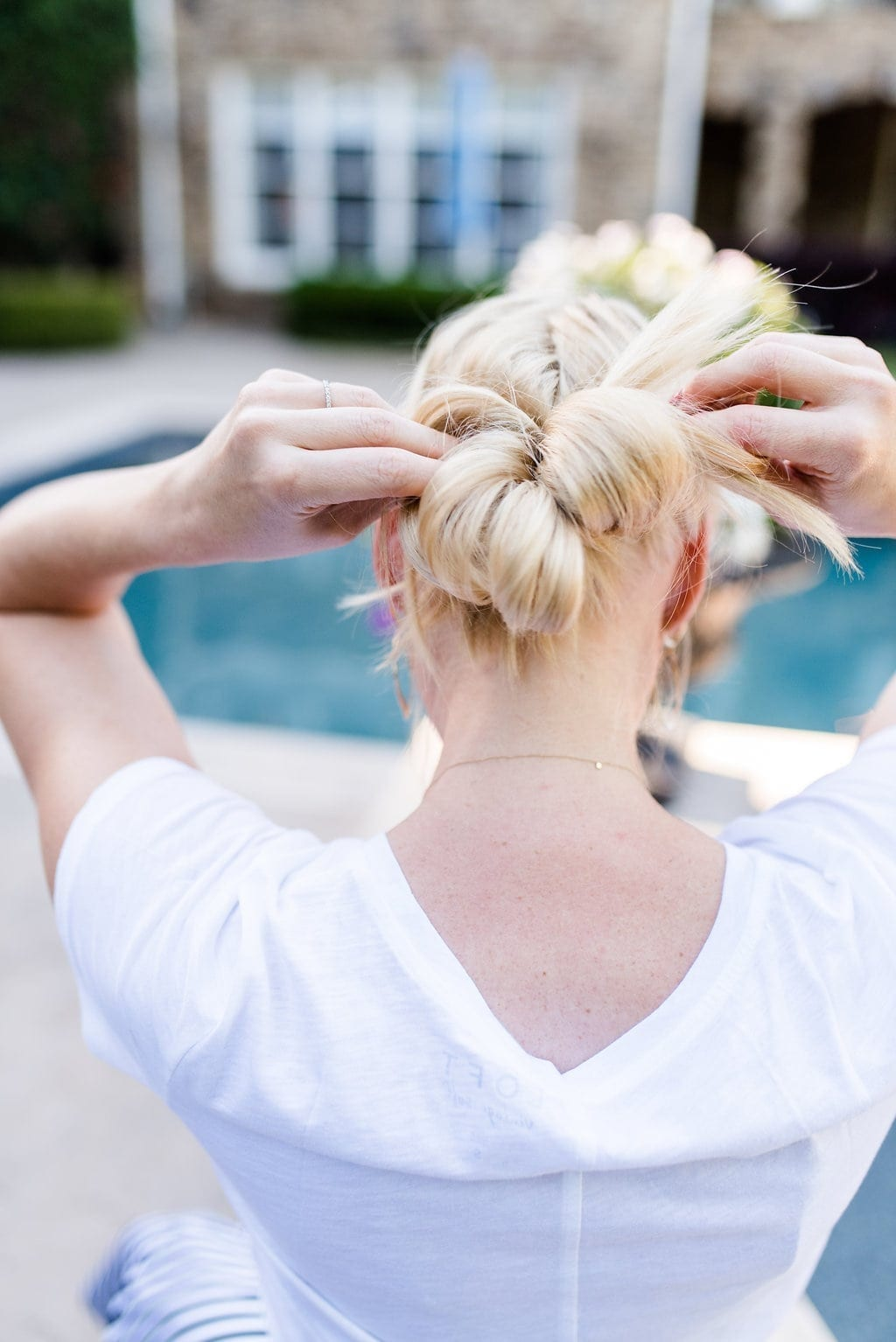 Low Bun hairstyle with braids.