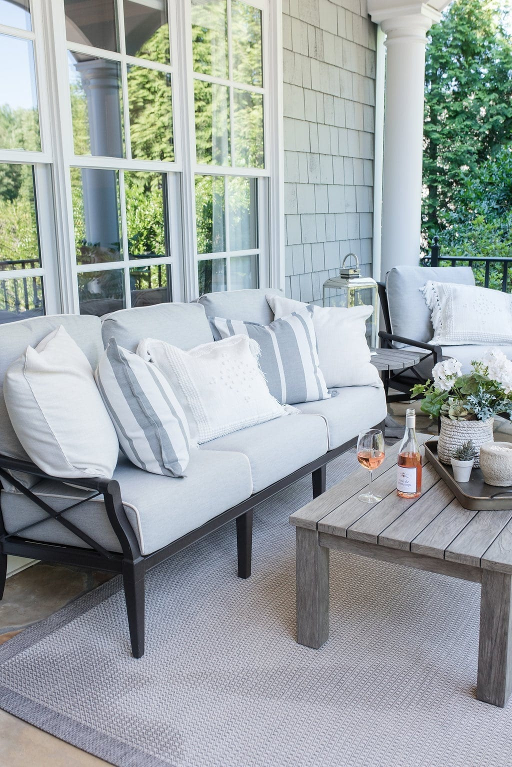 Lifestyle blogger bluegraygal balcony decor. Woodard Furniture and Serena and Lily accessories.