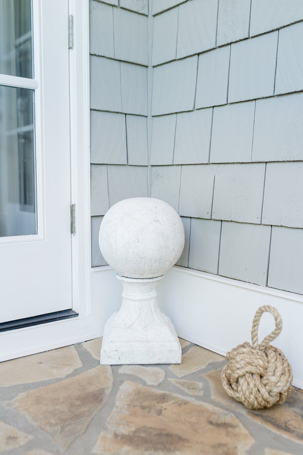 Knot door stopper and white ceramic finial.