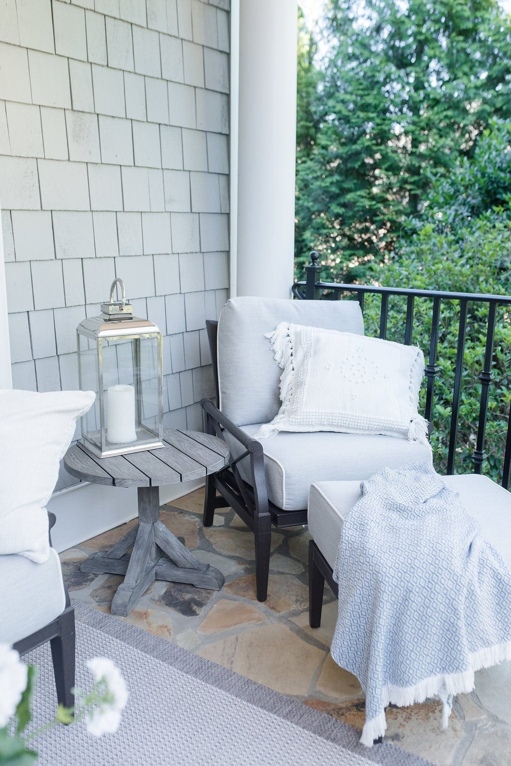 Woodard Outdoor Furniture. Lounge chair that rocks outside and teak side table.