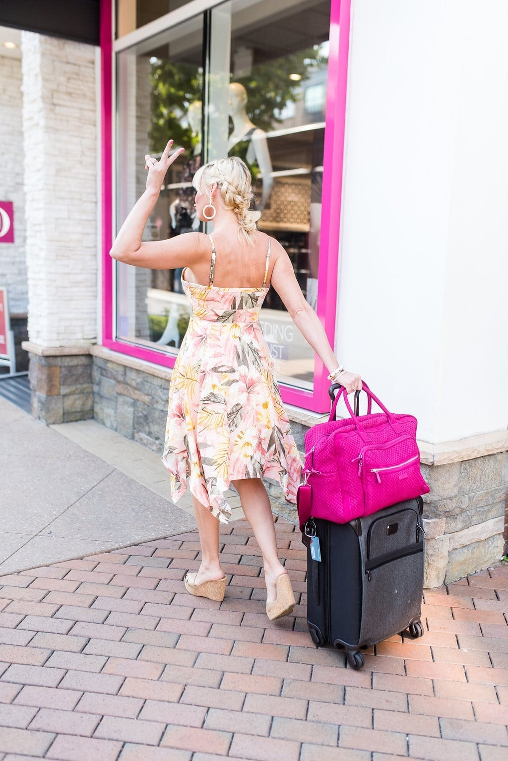 Vera Bradley Luggage and floral midi dress with braid hair updo.