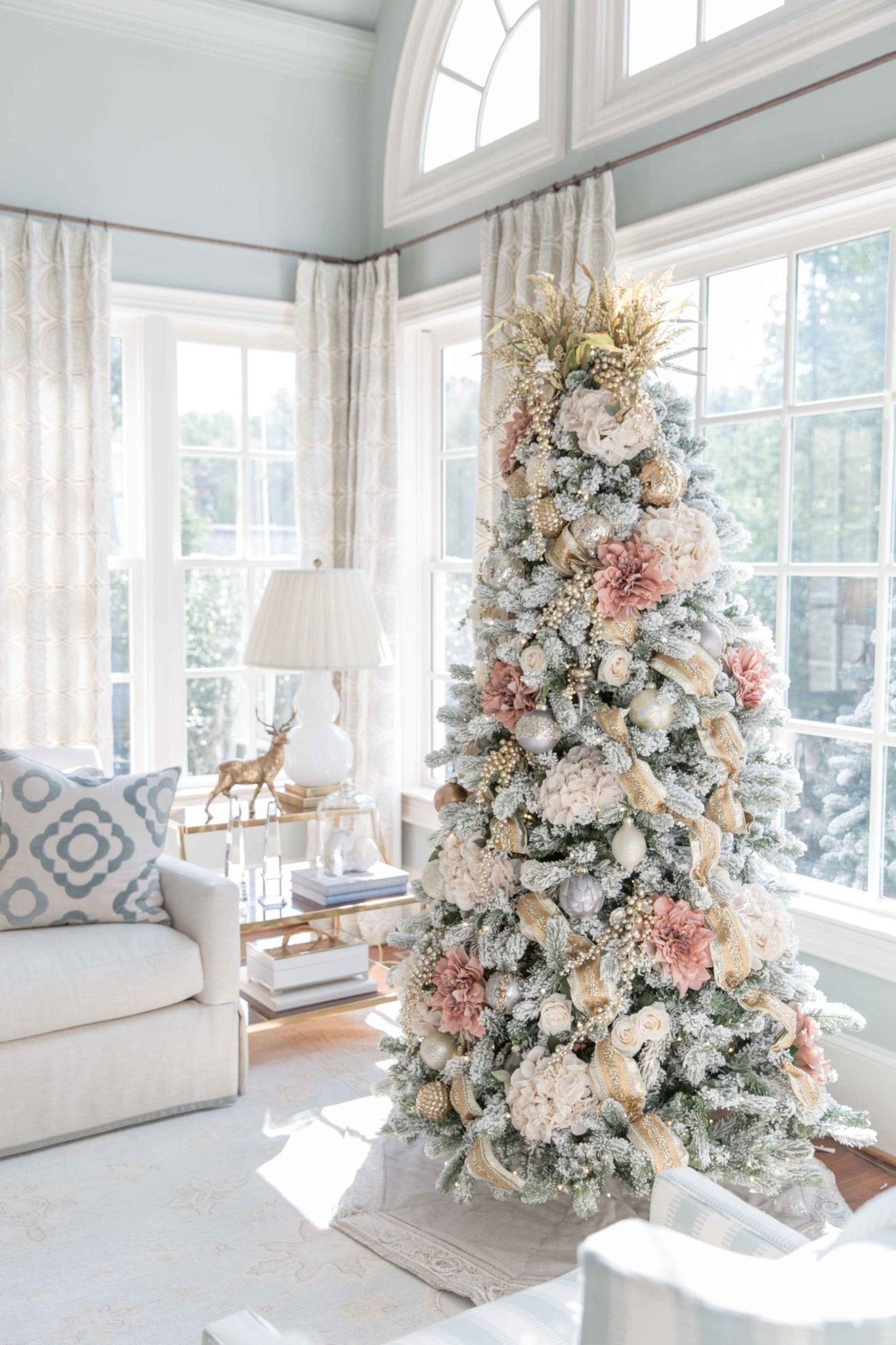 Decorate this Christmas with new color schemes! Pink flowers, gold ribbon and a fluffy gold tree topper! A somewhat rustic tree that's still very elegant!