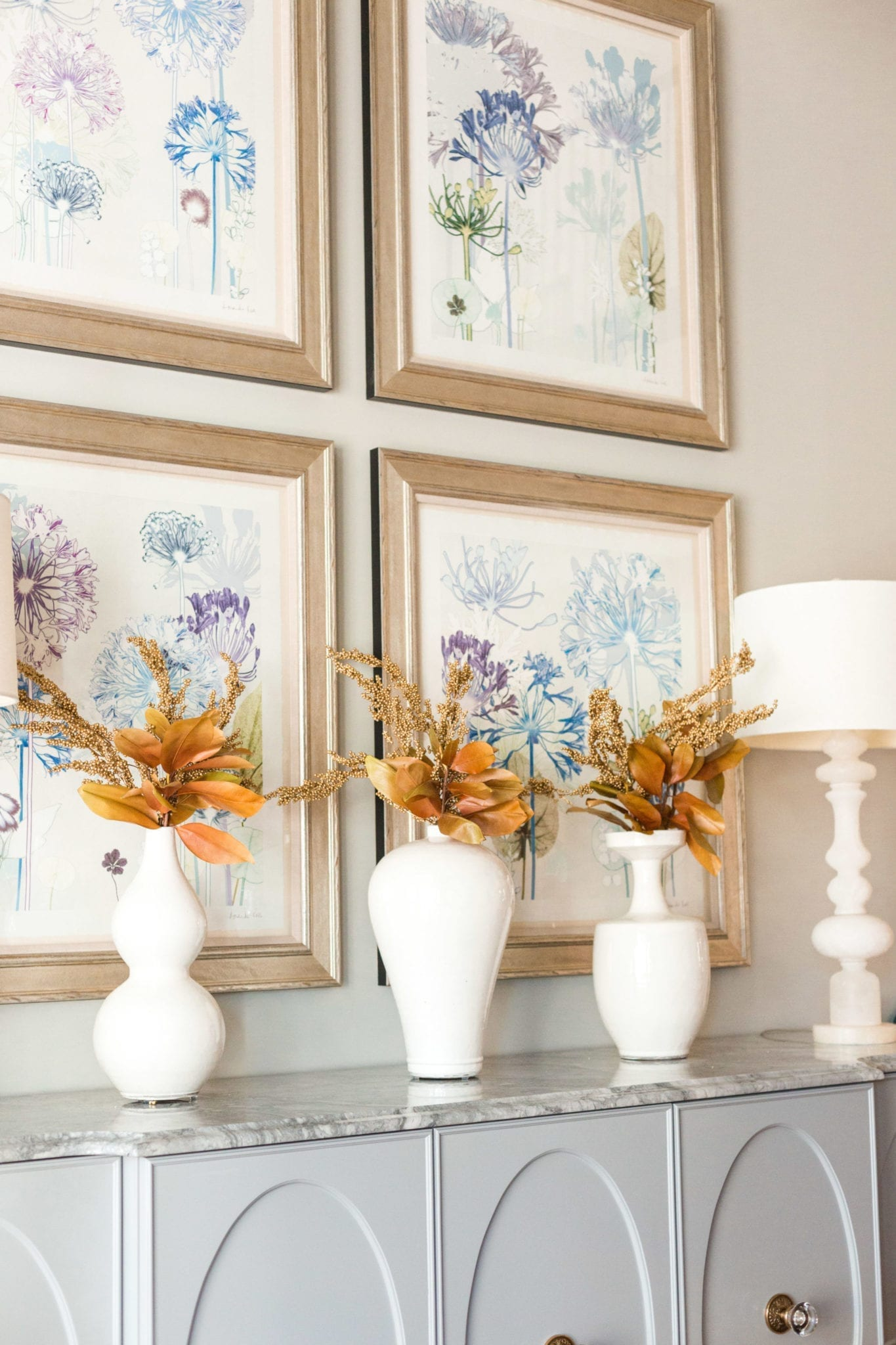 White Frontgate Vases with brown fall leaves.