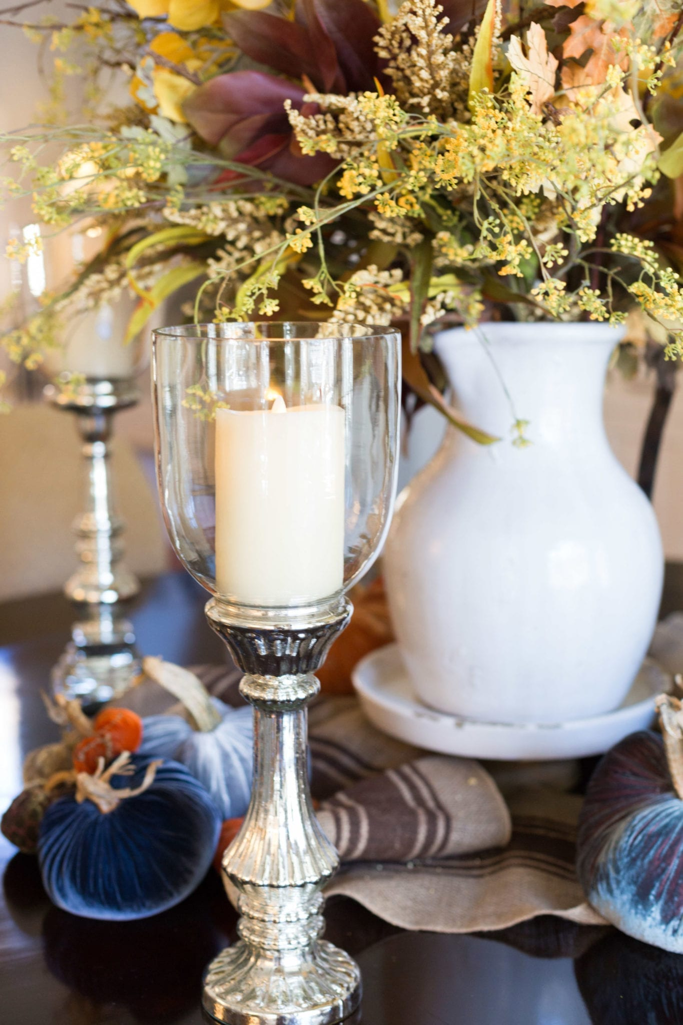 Mercury Glass Candlestick with fake candlelight. An elegant and rustic fall centerpiece!