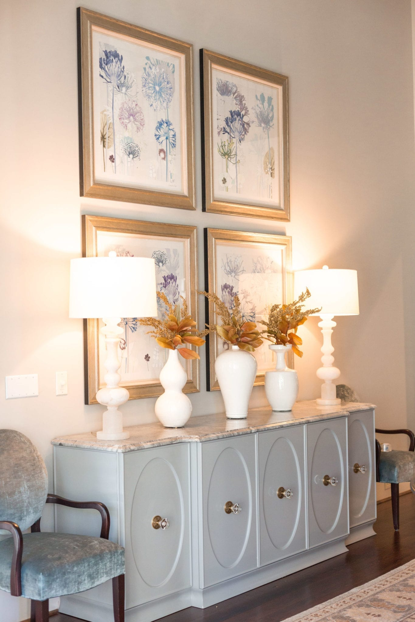 Dining room buffet console. Modern buffet with a little bit of white vases and fall leaves.