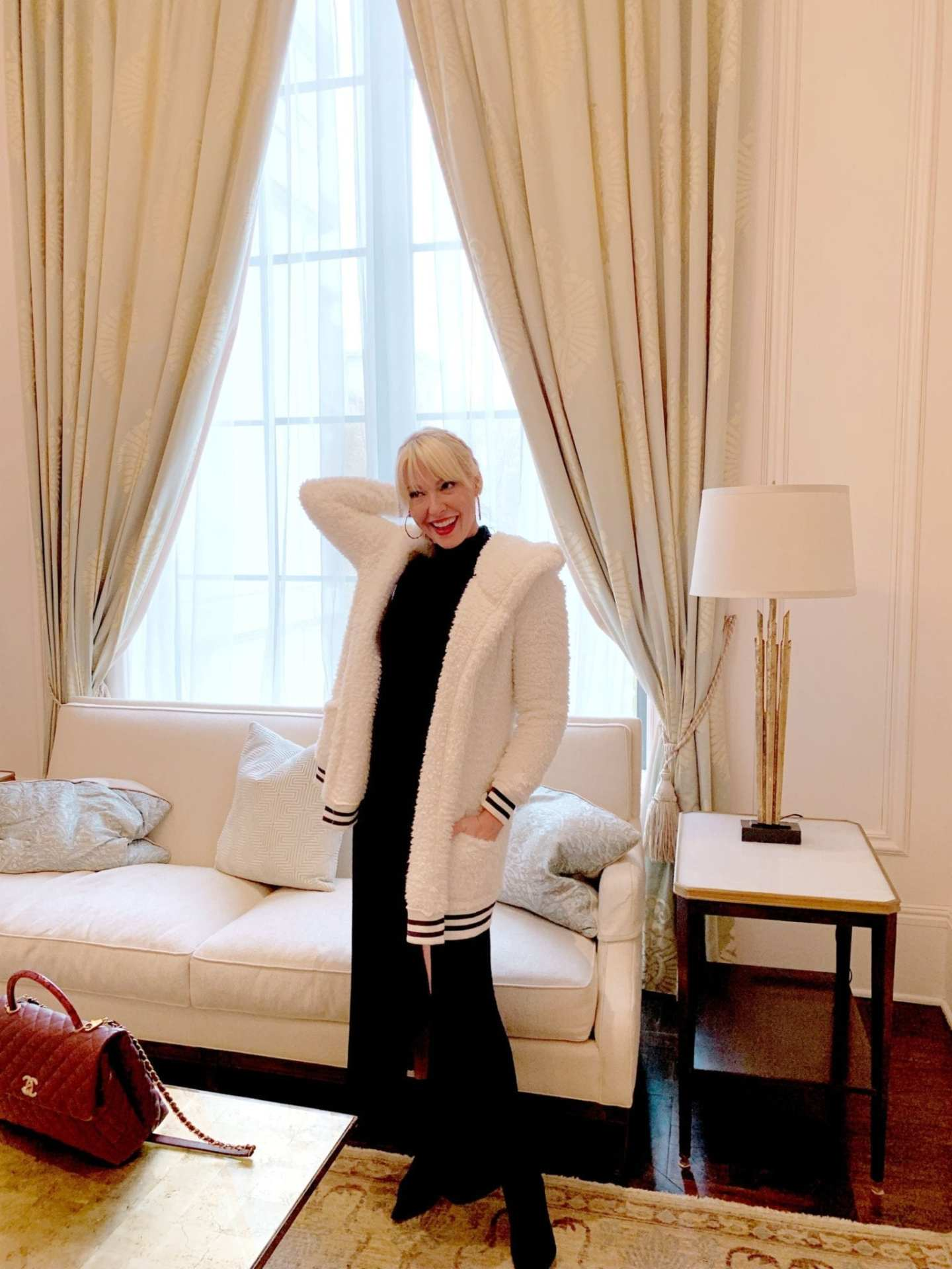 Cozy White Sweater Jacket from Make and Model with black long sleeve dress.
