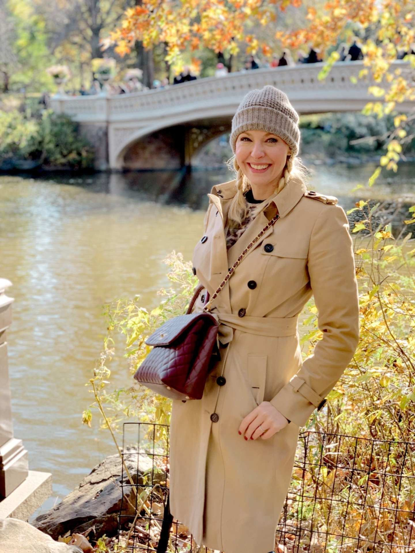 Burberry Trench Coat and Burgundy Chanel bag.