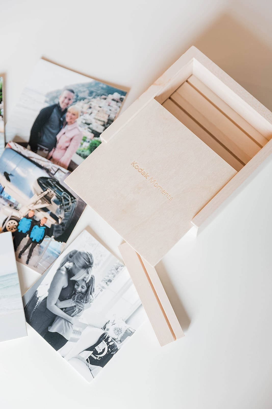Looking for creative photo display ideas? This box is the bomb! Print ten photos once and change them all year to display!