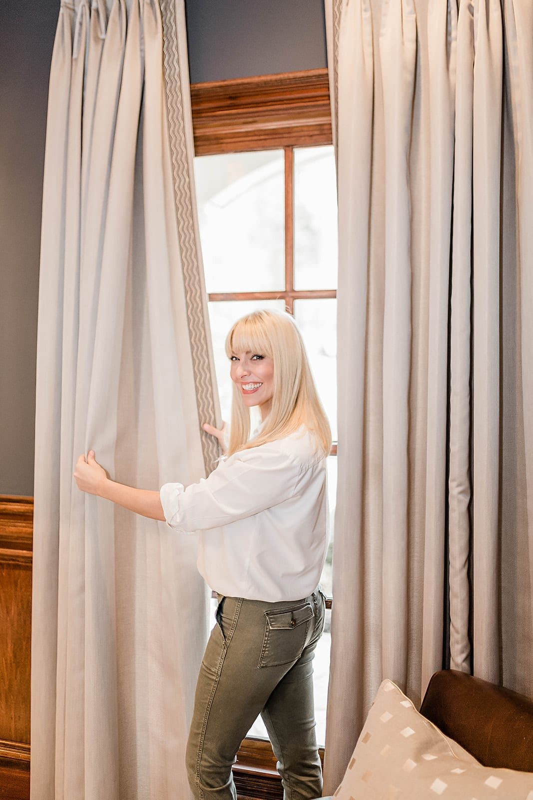 Lifestyle blogger Kelly Page, of bluegraygal, shows off her custom draperies made by Calico.