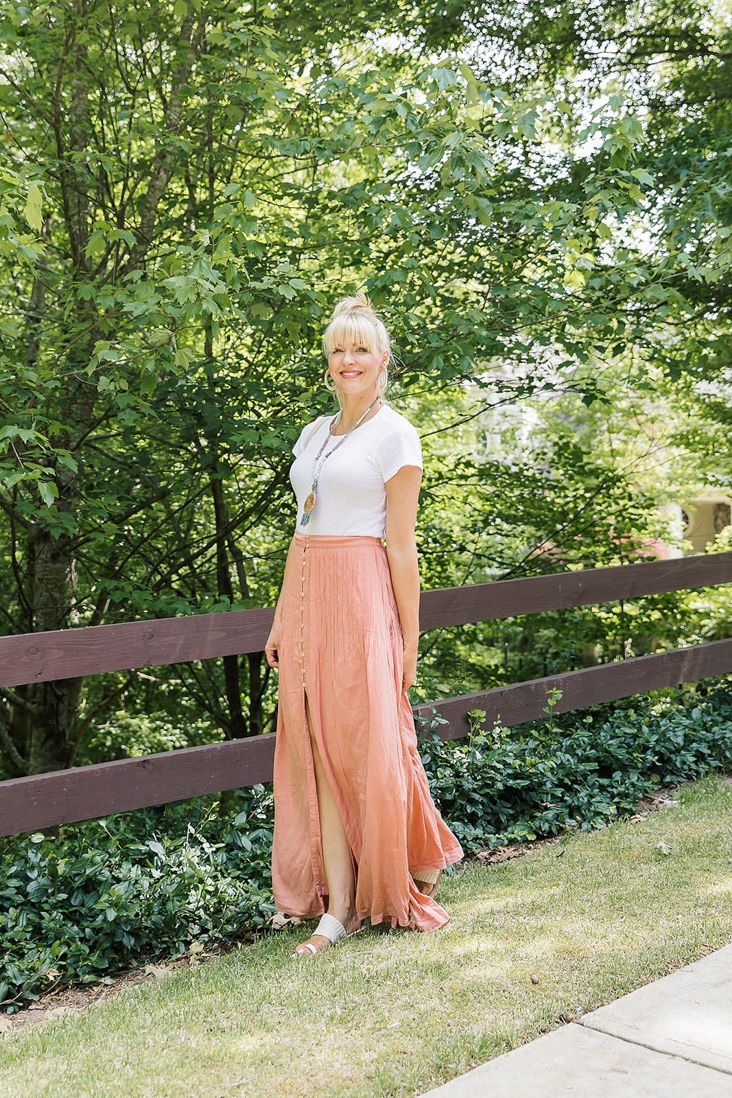 Pleated Maxi Skirt for summer fashion. Pretty color maxi skirt with white bodysuit and summer hairstyle.