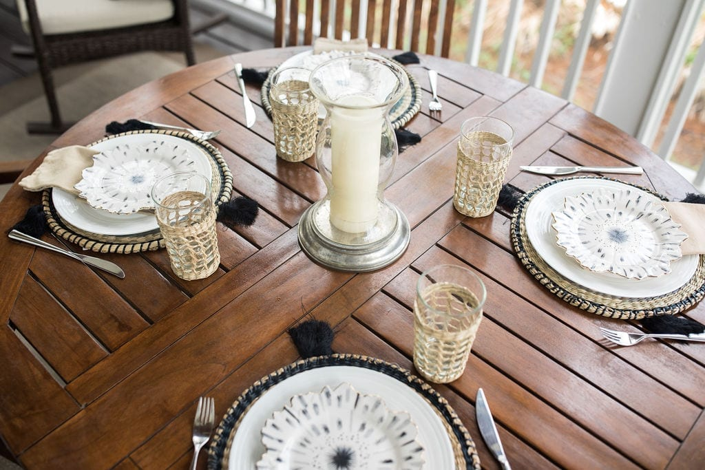 Gold and black table decor. Elegant, easy, summer table centerpiece for a round outdoor dining table.
