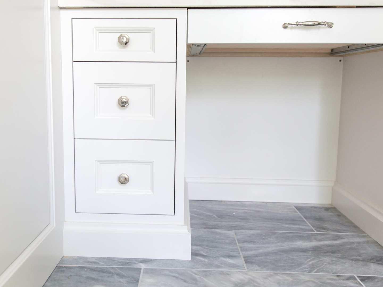 Bathroom cabinets with VESTA polished nickel hardware. Elegant hardware with gray marble floor.