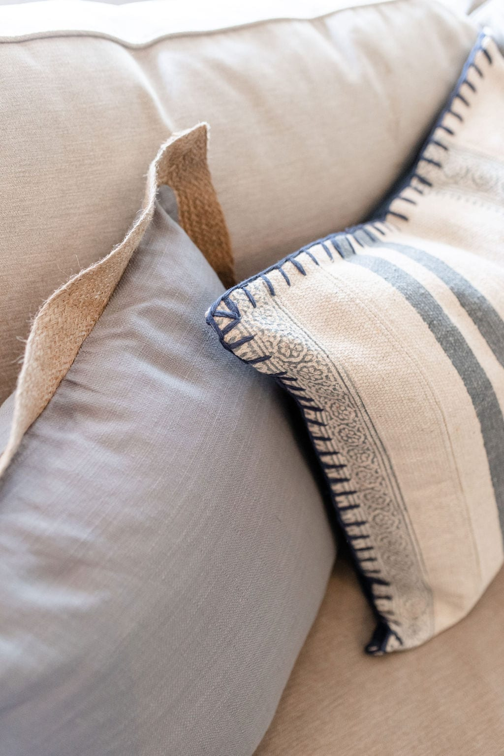 Inexpensive throw pillows. Decorating without spending too much money on home decor accents in blue and light brown colors.