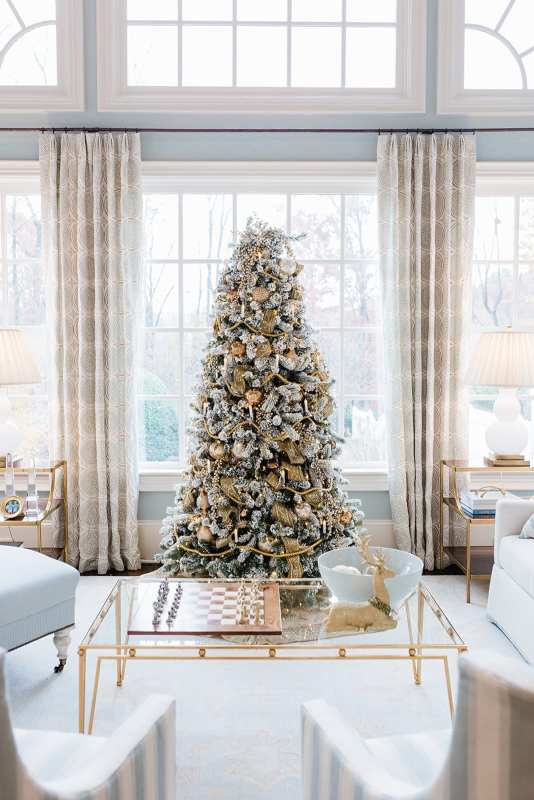 Gold Flocked Christmas Tree decorated by home blogger Kelly Page, for BlueGrayGal. Soft blue and gray living room with gold Christmas tree.