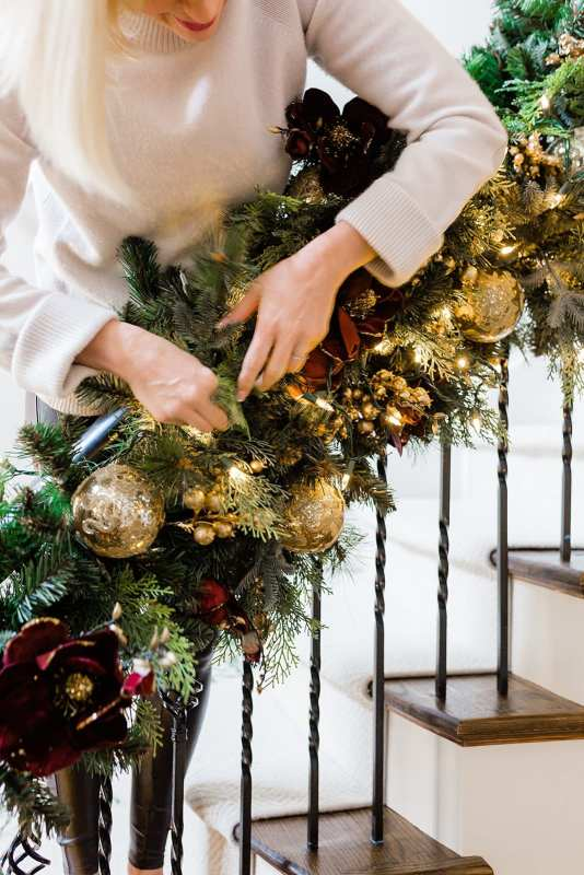 Hanging Garland on Staircase with blogger BlueGrayGal. Frontgate merlot and gold garland.
