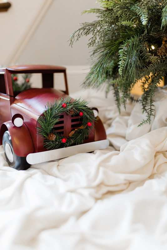 Red Christmas Truck with Ivory Christmas Tree Skirt. Christmas decor accessories.