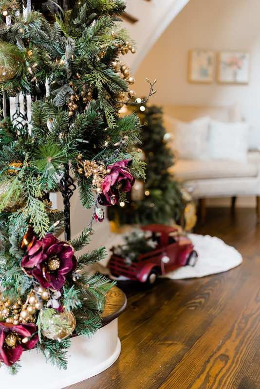 Magnolia Garland with burgundy and gold glitter ornaments.
