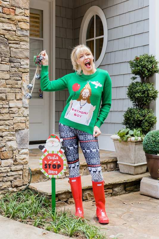 Terez Christmas Leggings with Reindeer on them, red rain boots and Jesus Birthday Boy Christmas sweater.