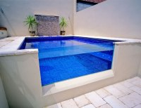Creating an oasis in a sloped backyard | Blue Haven Pools