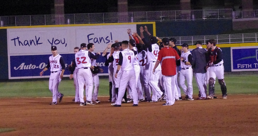 The Lansing Lugnuts celebrate on the field after their walkoff win to sweep the Great Lakes Loons in the first round of the Midwest League playoffs.