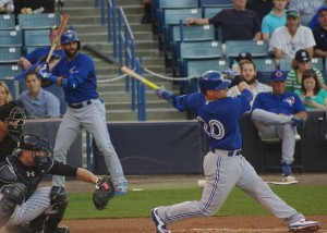 Josh Donaldson swings and Jose Bautista watches