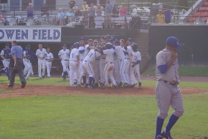 Dawel Lugo (31) is mobbed by his teammates after hitting a walkoff home run against the Burlington Royals in Appalachian League action on July 19, 2013.