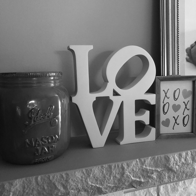 Social Distancing Decor on mantel a jar and a sign the reads love