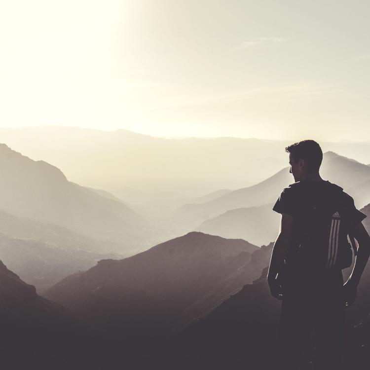 Man standing on summit