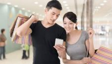 young couple phone shopping small 1