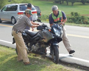 Crews move wrecked motorcycle from roadway. -- Photo by Yvette Stafford