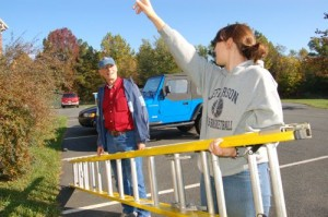 Erin Hopke, pointing, gets help from RVCC board member, Bill Howard, in preparation of APO's community service project.