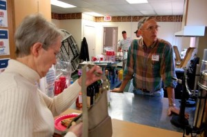 Henri Weems who volunteers with RFSF tends bar at Taste of Nelson.