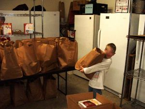 A youngster gets one of the many holiday meal sack provided by the Nelson Food Pantry.