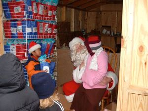 Photos By Nelson County Pantry : Santa chats with one of the kids that came by this past weekend.