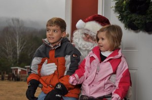 Photo By Benjamin Hernandez  : Two youngsters pose with Santa this past weekend at MountainSide Petting Farm.