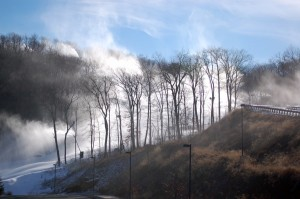 Snow making gear at Wintergreen fills the air with light snow over the slopes.