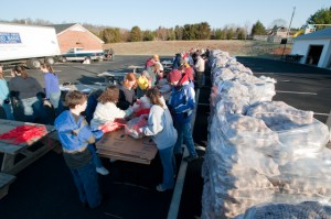 ©2009 NCL Magazine : Photos By Ben Hernandez : 40,000 pounds of potatoes set on the parking lot at Nelson United Methodist Church in Arrington, Virginia near Colleen. Click any photo for larger view.