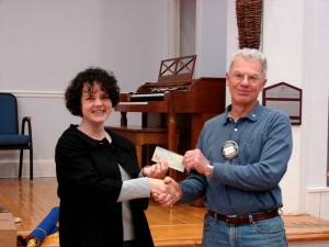 ©2009 NCL Magazine : Photo courtesy of Nelson Rotary Club : Margaret Clair accepts Rotary International Check from George Bonheyo