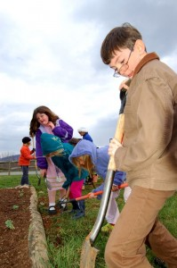 ©2009 NCL Magazine : Students at Rockfish River Elementary work in the chilly weather this week to complete their butterfly garden.