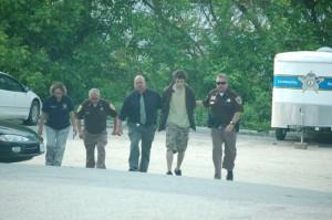 © 2009 Nelson County life Magazine. Photo by Tommy Stafford. 20 year-old Austin Griffin is led into The Nelson County Courthouse on May 11th by Sheriff David Brooks.(far right) Inv. Becky Adcock, Capt. Ron Roberson, and Inv. Paul McCormick accompany Griffin.