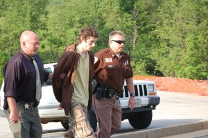 ©2009 NCL Magazine : 20 year old Austin Griffin is lead to a bond hearing Monday afternoon by Augusta County Investigator, Paul McCormick and Nelson Sheriff David Brooks on the far right. Click on any image for larger view.