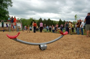 Folks from all over Nelson turned out for dedication of the playground Saturday morning.