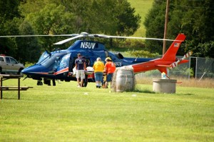 Another Route 6 accident victim is loaded into a Pegasus helicopter at the RVCC landing zone.