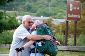 Sandy's husband, Bill, greets her after her 107 mile journey ending Thursday afternoon.