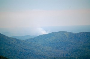 Photo By Tommy Stafford : ©2009 www.nelsolncountylife.com : A fire can be seen off in the distance looking east from the overlook above Wintergreen Resort Thursday afternoon.