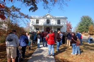 A crowd of fans wait outside the Hamner home place in Schuyler on Saturday.