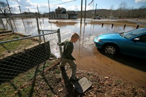 Trevor Bantoni, 7 plays in his front yard in Gladstone, Va., Monday January 25, 2010. The main street in the town flooded early Monday morning. The Gladstone Volunteer Fire Department was setting up hoses to begin pumping water from the street. The water came up to the front steps of most homes, but didn't enter them.