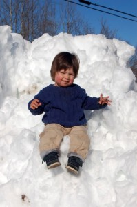Now that Adam has finished piling up the last snow, he waits on the next!